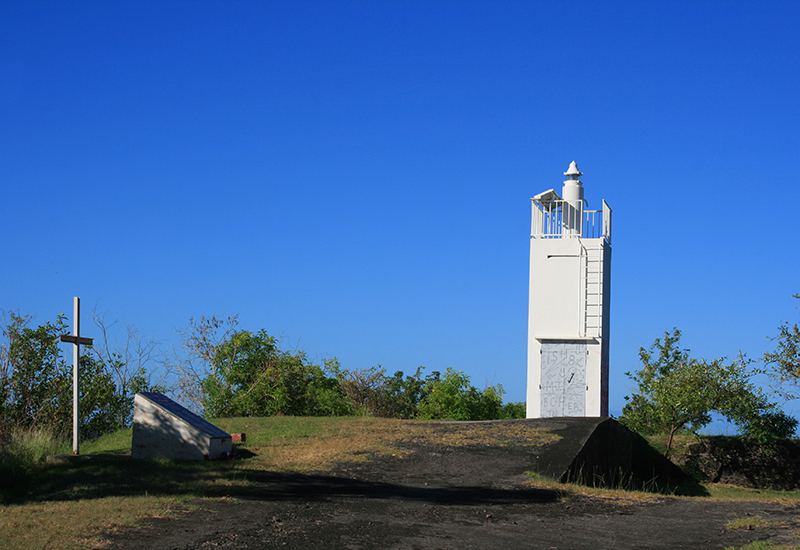 Lighthouse at Pointe de l'Anse. Nearby was erected a stele in memory of the victims of the public transport accident