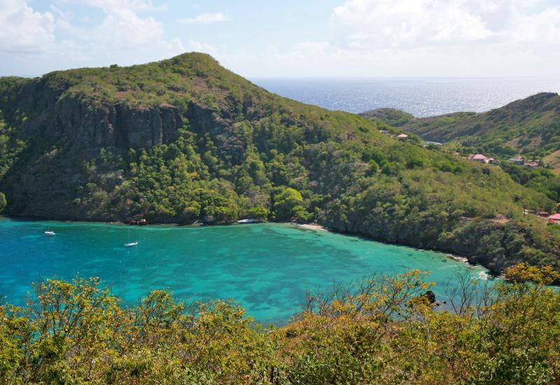 The bay with turquoise waters dominated by Morne Morel