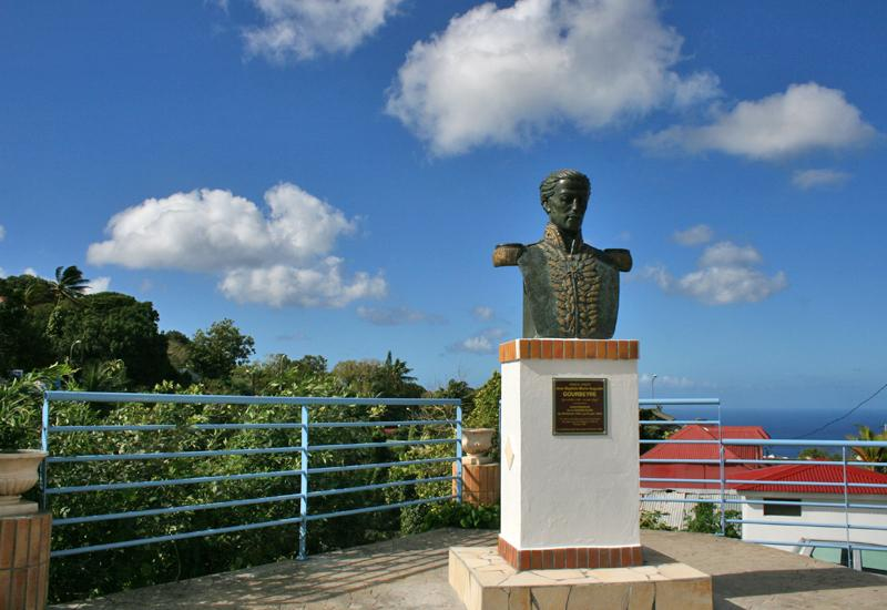 In the city of Gourbeyre, en Guadeloupe, the bust of Gourbeyre high on a promontory, facing the Town Hall