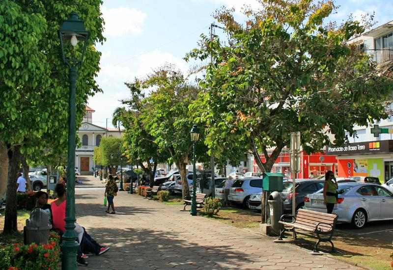 Cours Nolivos - Basse-Terre. Facing the shady square, many shops