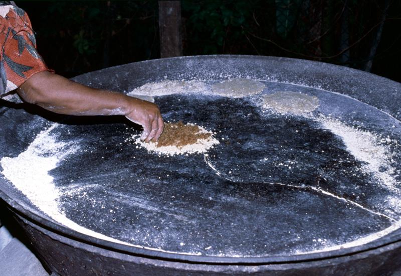 "The resulting pulp is spread on large ""platines"" (metal griddles)"