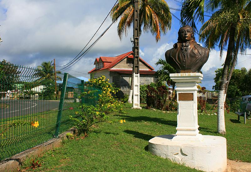 City of Goyave, Guadeloupe, the bust of Delgrès erected in the heart of a flower garden