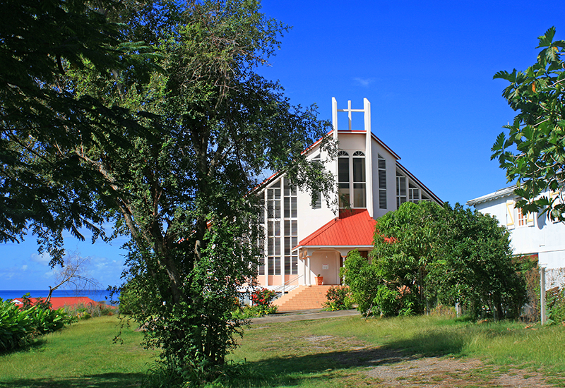 Vieux-Habitants, Adventist Church. Overlooking the sea, in a park